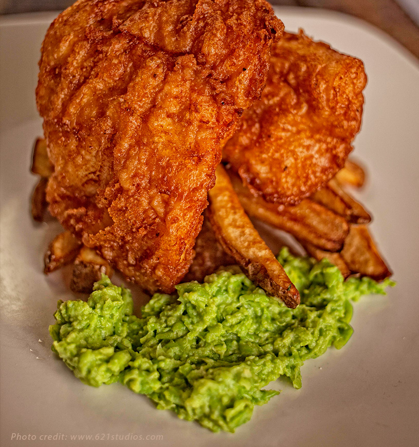 Traditional beer battered fish and chips with mushy peas